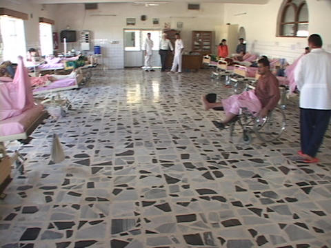 Wounded men lie in an Iraqi hospital in Iraq Footage
