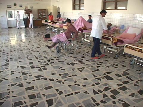 Wounded men lie in an Iraqi hospital in Iraq Stock Video Footage