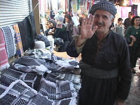 A vendor waves a friendly greeting on a street in Kurdistan, Iraq Footage