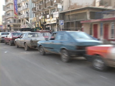 Cars wait in long lines for gas in Baghdad, Iraq Stock Video Footage