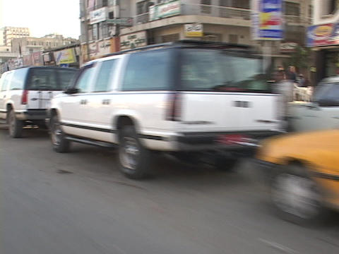 Cars wait in long lines for gas in Baghdad, Iraq Footage