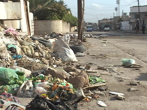 Trash fills the sidewalks and falls into the streets in... Stock Video Footage