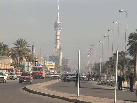 Traffic flows on a busy street in Baghdad, Iraq Stock Video Footage