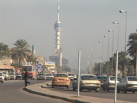 Traffic flows on a busy street in Baghdad, Iraq Footage