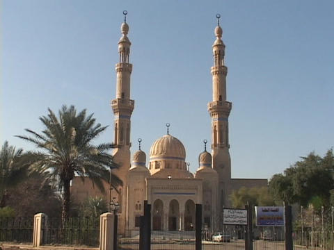 Worshipers enter and exit a beautiful mosque in Baghdad, Iraq Footage