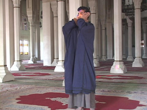 A Muslim muezzin leads a prayer call in a Baghdad mosque Footage