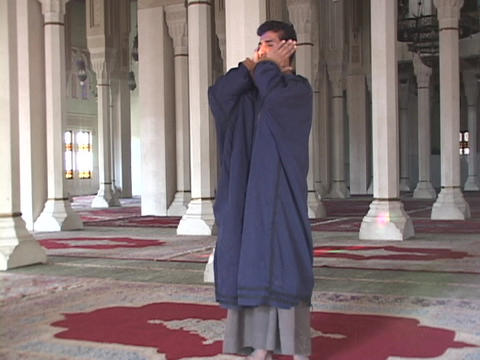 A Muslim muezzin leads a prayer call in a Baghdad mosque Stock Video Footage