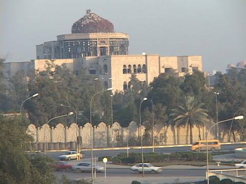 Traffic moves briskly in war-torn Baghdad, Iraq Stock Video Footage