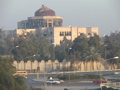 Traffic moves briskly in war-torn Baghdad, Iraq Footage