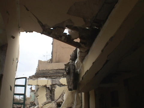 A ruined building shows damage from bombings in war-torn... Stock Video Footage
