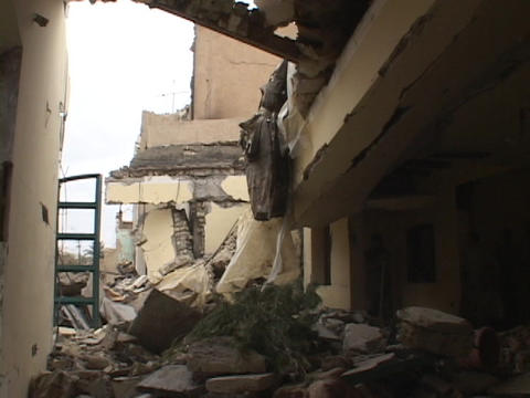 A ruined building shows damage from bombings in war-torn Baghdad, Iraq Live Action