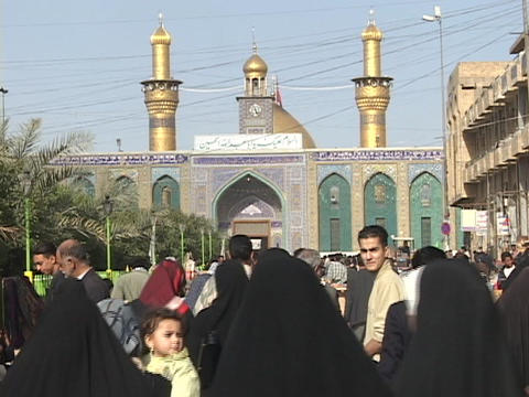 Crowds of Iraqis walk toward a mosque in Baghdad, Iraq Footage