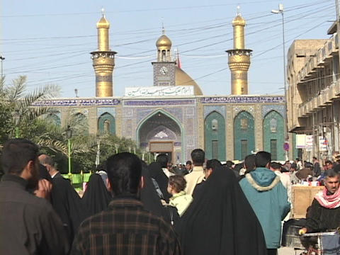 Crowds of Iraqis walk toward a mosque in Baghdad, Iraq Stock Video Footage