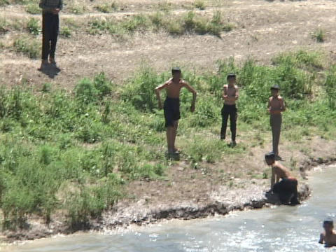 Young boys jump into a river for fun in Iraq Stock Video Footage
