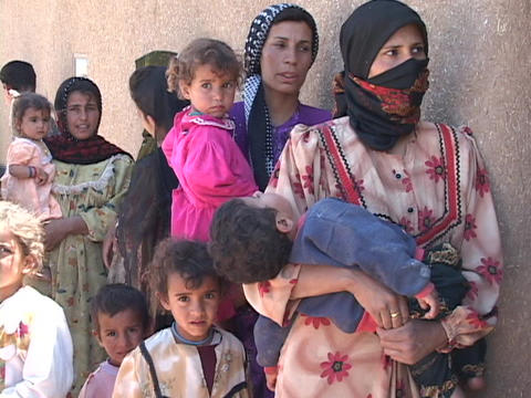 Women and children wait to get into a rural medical... Stock Video Footage