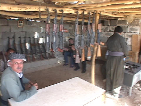 Weapons dealers watch over their guns in Northern Iraq Stock Video Footage