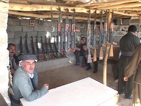 Weapons dealers watch over their guns in Northern Iraq Footage