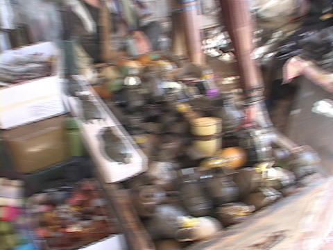 A weapons dealer watches over a pile of grenades in... Stock Video Footage