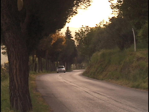 A car drives down a country road Footage