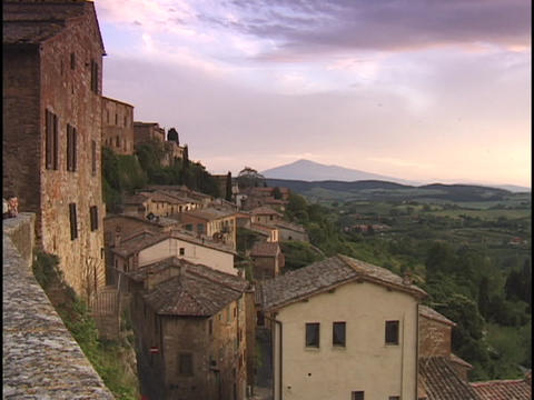 Houses cling to a hillside in Italy Stock Video Footage