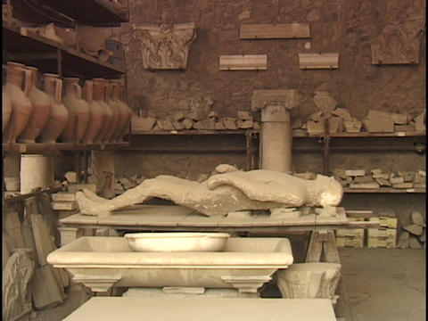 A Pompeii mummy lies in an archaeological dig workshop Stock Video Footage
