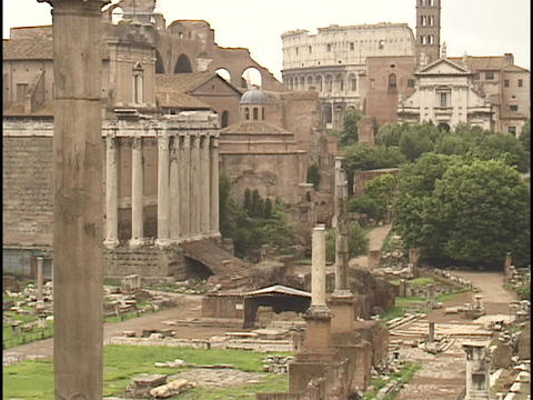 The ancient Coliseum towers over other Roman ruins Stock Video Footage