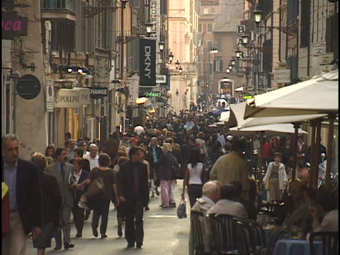 Pedestrians walk through a busy shopping district in... Stock Video Footage