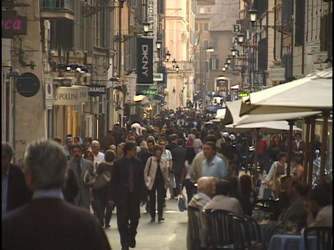 Pedestrians walk through a busy shopping district in Rome, Italy Live Action