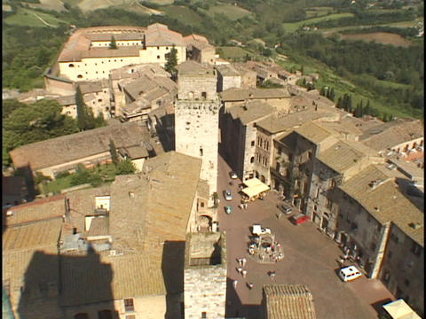 The hills of Tuscany surround the walled village of San Gimignano Footage