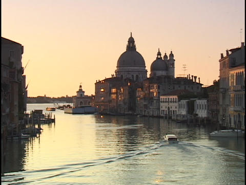 A small boat motors through the Grand Canal, passing in... Stock Video Footage