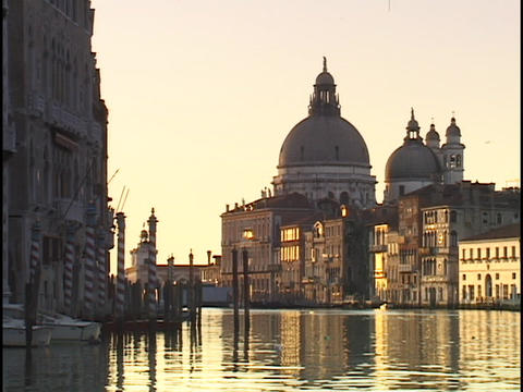Historic Venetian buildings reflect in the still waters of the Grand Canal in Italy Footage