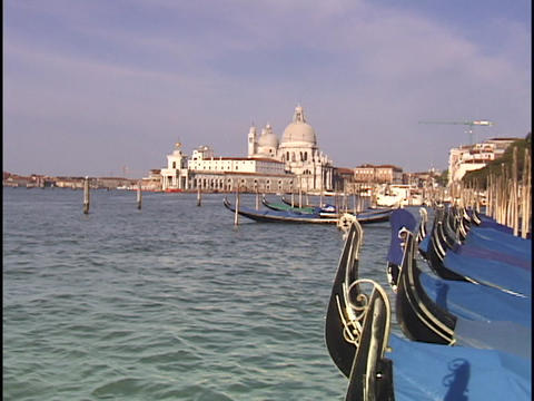 Moored gondolas bob up and down in the choppy waters of... Stock Video Footage