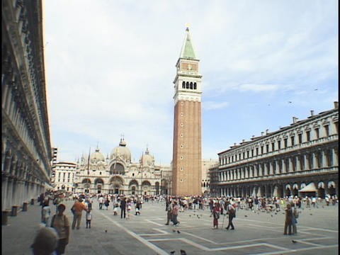 Visitors wander through St. Mark's Square in Venice, Italy Stock Video Footage