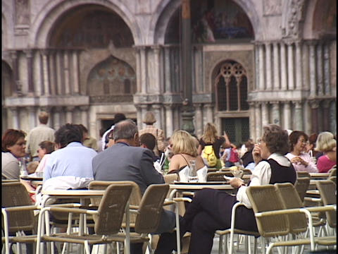 Visitors sit at an outdoor cafe at Saint Marks Square in... Stock Video Footage