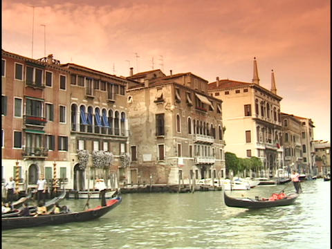 Gondolas cruise down the Grand Canal in Venice, Italy Stock Video Footage