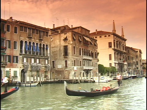 Gondolas cruise down the Grand Canal in Venice, Italy Footage