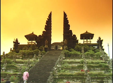 A monk climbs a long staircase to a temple Stock Video Footage