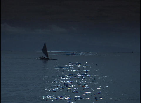 A small sailboat drifts across the ocean Stock Video Footage
