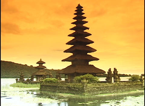 Asian structures stand on an island in front of a vivid sky Stock Video Footage