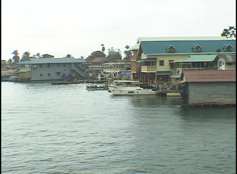 Boats sit at the docks of waterfront homes Stock Video Footage