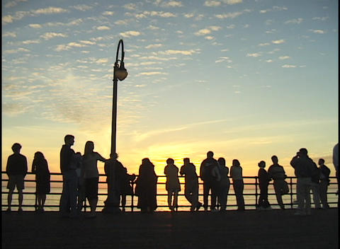 A crowd of people stand on a pier Stock Video Footage