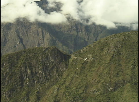 White clouds float over the peaks of the Andes mountains Footage