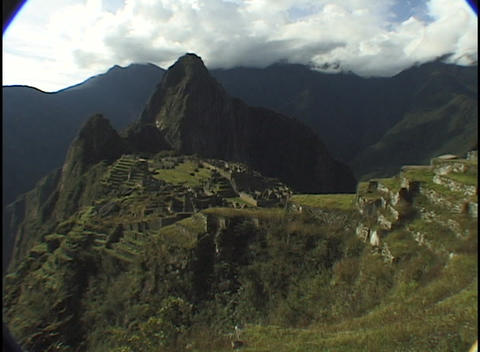 The ancient ruins of Machu Picchu lie in the mountain... Stock Video Footage
