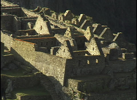 Stone walls and peaked rooftops line the hillsides at the... Stock Video Footage