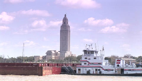 A river barge passes in Baton Rouge, Louisiana Stock Video Footage