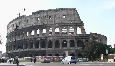 The Coliseum in Rome with traffic passing Stock Video Footage