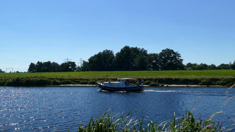 On the banks of the river Ijssel, boat passing by Footage