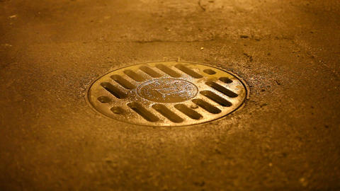 Vapour fly out manhole covered with iron hatch, close up asphalt road view Footage