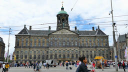 Time lapse - Dam square on a sunny day with locals and tourists at the square an Footage