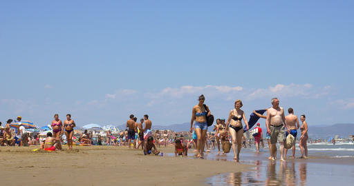People Have Fun At Balearic Sea On Valencia Beach In Summer Footage
